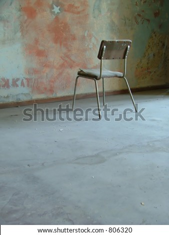 simple room with a single chair - stock photo
