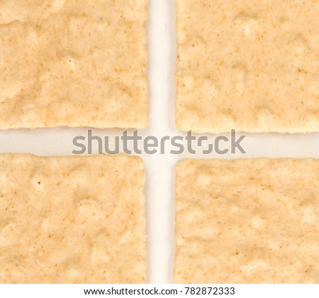 Simple square crackers isolated on a white background
