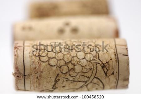 Simple studio shot of three wine corks. Focus on 1st cork, shallow DOF. - stock photo