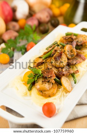 Simple Summer Meal of Sauteed Potatoes, Green Beans, Mushrooms Served Over Spaghetti Squash - stock photo