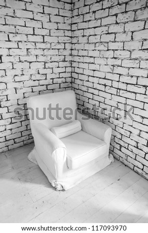 simple white wall  interior with armchair in corner - stock photo
