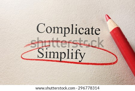 Simplify and Complicate red circle with pencil on textured paper                                - stock photo