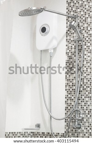 simply modern bathroom with shower head and water heater. - stock photo