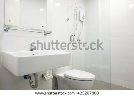 simply white bathroom in hotel.