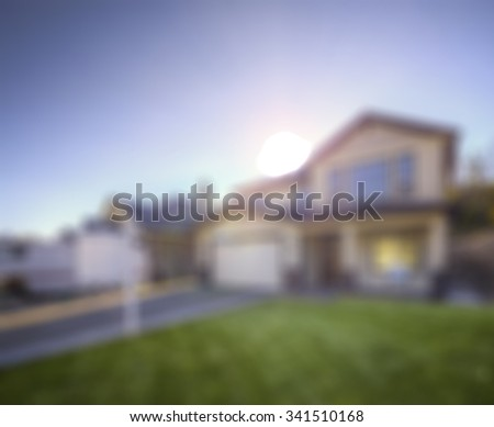 simulated out of focus blurry view of a residential building exterior - stock photo