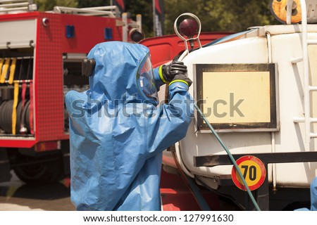 Simulation of a chemical accident - stock photo