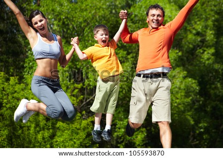 Simultaneous family jump manifesting love for life and vitality - stock photo