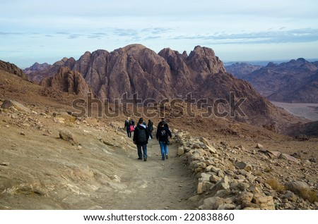 SINAI,  EGYPT - NOVEMBER 28, 2013: unknown tourists descend from the top of Moses Mountain in November 28, 2013 in Sinai, Egypt - stock photo