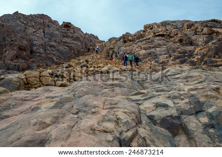SINAI MOUNTAINS, EGYPT - NOVEMBER 28, 2013: Unidentified tourists descend from Mount Moses, Egypt - stock photo