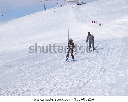 SINAIA, ROMANIA - DECEMBER 11, 2015. Skiers on the slope in Sinaia, the most famous mountain resort in Romania.