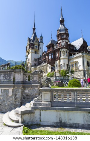 SINAIA, ROMANIA - JULY 24: Unidentified tourists walk the alleys of Peles castle garden on July 24, 2013 in Sinaia, Romania. Every year, more than 300.000 tourists visit the famous Peles castle.