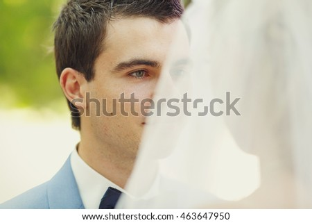 Sincere glance of the groom on the wedding ceremony