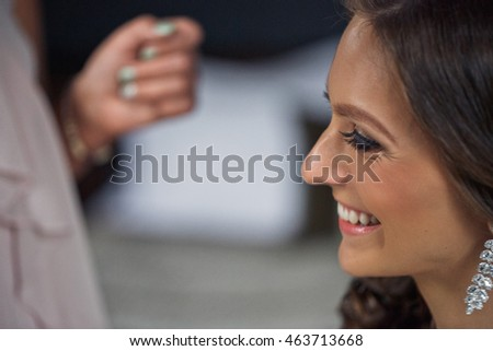 Sincere smile of the bride during preparation