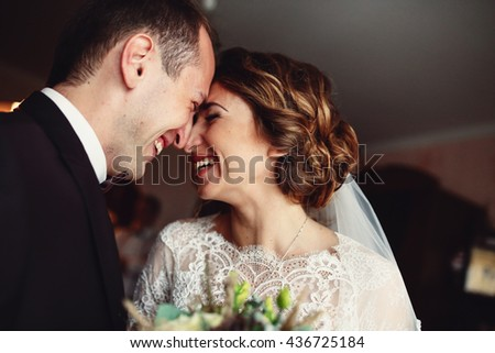 Sincere smiles of the bride and a groom