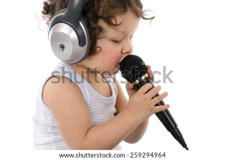 Sing baby with headphone and microphone,isolated on a white background. - stock photo