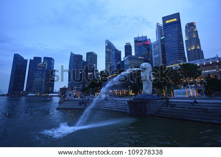 SINGAPORE-Apr 30:Th e Merlion fountain  Apr 30, 2012 in Singapore.Merlion is a mythical creature with the head of a lion and the body of a fish,and is a symbol of Singapore. - stock photo