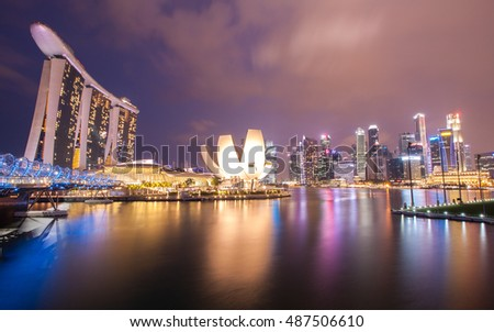 SINGAPORE - 10 APRIL 2016: A view of Marina Bay with Art Museum and downtown city during twilight time. Its name usually refers to Lion.