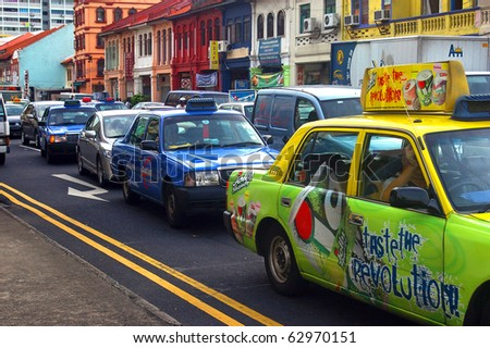 SINGAPORE - APRIL 29: Cars and taxis fill grid locked streets, April 29, 2010, Singapore. The government will spend SGP$14 billion to improve Singapore's road infrastructure over the coming years.
