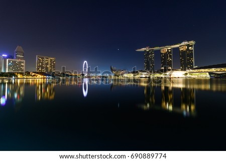 SINGAPORE - APRIL 15, 2017 : Cityscape in dawn time of Marina Bay Sands Hotel in Singapore, Marina bay, Singapore flyer, Art Science Museum are famous landmarks of tourist in Singapore.