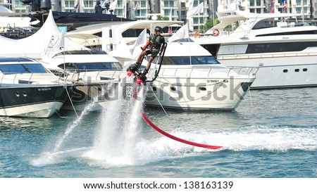 SINGAPORE - APRIL 20: Demonstration of Zapata Racing water propelled flyboard at the Singapore Yacht Show 2013 at One Degree 15 Marina Club, Sentosa Cove April 20, 2013 in Singapore