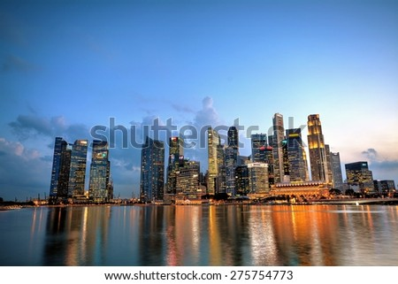 SINGAPORE - APRIL 30,2015: Financial district skyscrapers and the Jubilee Bridge at Merlion Park. A newly created pedestrian bridge at Marina Bay links Merlion Park to the waterfront promenade.