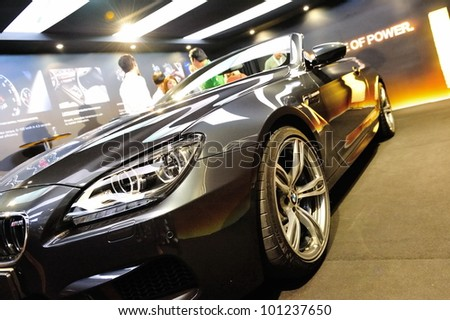 SINGAPORE - APRIL 28: Front of BMW M6 Convertible at its Preview at Singapore Yacht Show April 28, 2012 in Singapore - stock photo