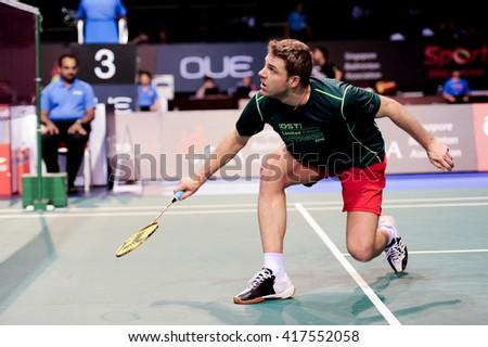 Singapore - 13 April 2016: Mens single Brice Leverdez of France versus Wang Zhengming of China in OUE Singapore Open 2016 preliminary rounds.