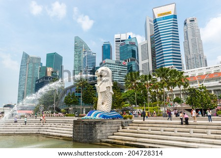 Singapore, APRIL 29: Singapore center with Merlion and skyscrapers on April 29, 2014 in Singapore. - stock photo