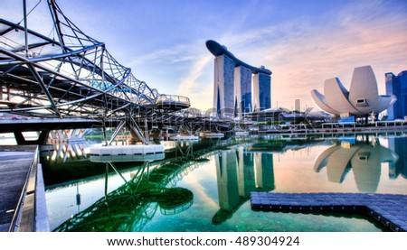 SINGAPORE, 4 April 2016 - Singapore's famous Marina Bay Sands and Helix footbridge at sunrise