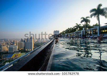 SINGAPORE - APRIL 5:Swimming pool of the Marina Bay Sands on April 5 , 2012 in Singapore. It's the world's most expensive standalone casino property at US$ 6.3 billion.