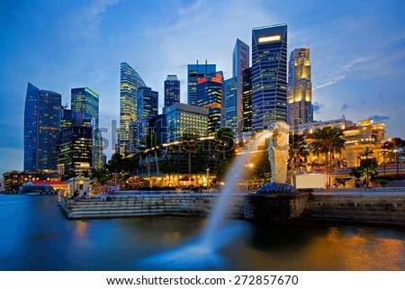 SINGAPORE-APRIL 23: The Merlion fountain and Marina Bay Sands on April  23, 2012. Merlion is an imaginary creature with a head of a lion and the body of a fish and is seen as a symbol of Singapore. - stock photo