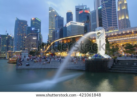 SINGAPORE-APRIL 10, 2016: The Merlion fountain in Singapore. Merlion is a imaginary creature with the head of a lion,seen as a symbol of Singapore - stock photo