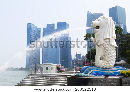 SINGAPORE - APRIL 23,2015: The Merlion fountain in Singapore on April 23,2015. Merlion is a imaginary creature with the head of a lion, symbol of Singapore. - stock photo