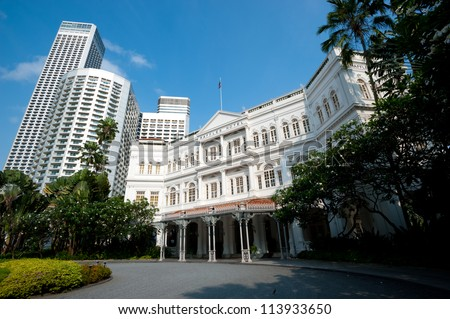 SINGAPORE - APRIL 23: The Raffles Hotel opened in 1899, and is named after Singapore's founder Sir Stamford Raffles. April 23, 2011 in Singapore, - stock photo