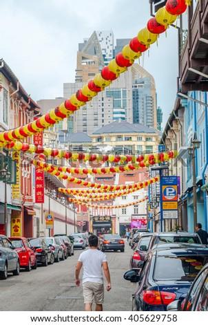 SINGAPORE - APRIL 3: Tourists walking along Singapore china town market unesco heritage in April 2016 - stock photo