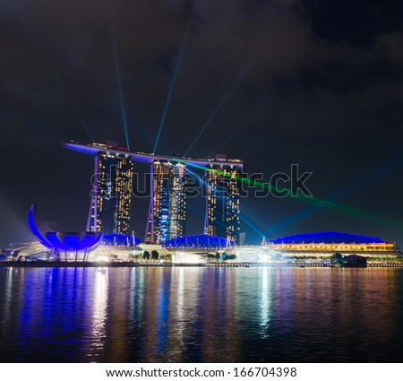 SINGAPORE - APRIL 7: View of Marina Bay Sands resort on april 7, 2011 in Singapore. Night Scene. Marina Bay is famous destination in Singapore.