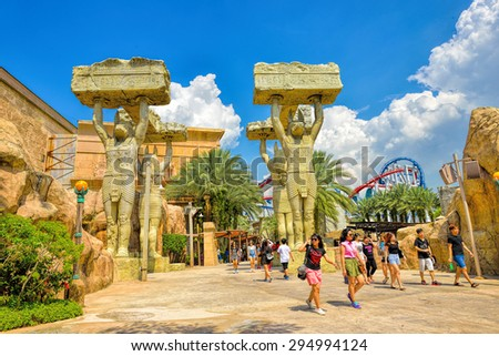 SINGAPORE - APRIL 18: Visitors walking at the Ancient Egypt on April 18, 2015 in Singapore. Ancient Egypt it is part of themed zone at the Universal Studios Singapore theme park. - stock photo