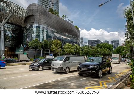 Singapore, Asia - August 4th. 2016 - Tourists walking around the downtown of Singapore in a blue sky day, Singapore, Asia.