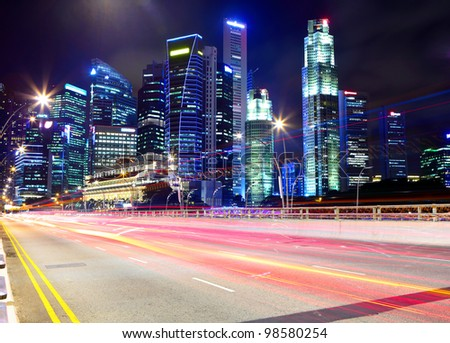 Singapore at night with traffic road - stock photo