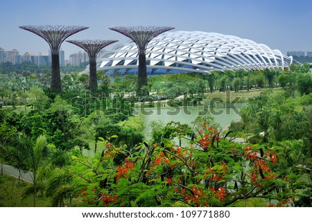 SINGAPORE-AUG 5: Day view of The Supertree Grove, Cloud Forest & Flower Dome at Gardens by the Bay on Aug 5, 2012 in Singapore. Spanning 101 hectares, and five-minute walk from Bayfront MRT Station. - stock photo