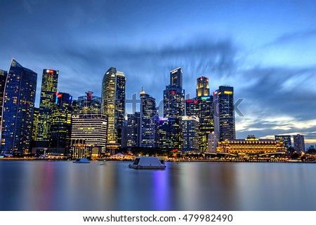SINGAPORE - AUG 31: Singapore business buildings area at night on AUG 31, 2016 in Singapore. Singapore is a world famous tourist city with highly developed economic infrastructure