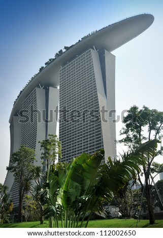 SINGAPORE - AUG 5: The Marina Bay Sands Resort Hotel on Aug 05, 2012 in Singapore. It is an integrated resort and the worlds most expensive standalone casino property at S$8 billion. - stock photo