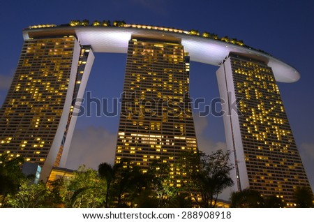 SINGAPORE- AUG 22: The Marina Bay Sands Resort Hotel on August 22, 2012 in Singapore. It is an integrated resort and the world's most expensive standalone casino property at S$8 billion. - stock photo
