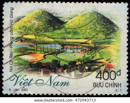 SINGAPORE ?? AUGUST 22, 2016: A stamp printed in Viet Nam shows Co Tien Mountain - Ha Giang Province, circa 2001