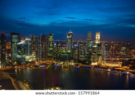 SINGAPORE - AUGUST 06: Famous Singapore skyline, on August 06, 2010 in Singapore. Singapore a former British colony became a quick growing economical anf financial power in Asia. - stock photo
