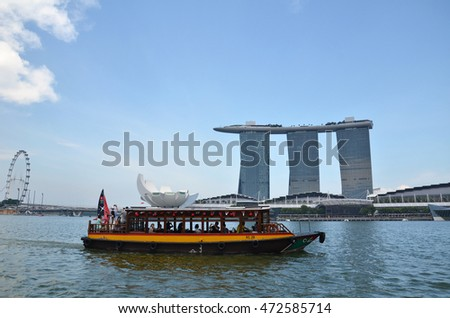 SINGAPORE - 07 AUGUST, 2016:  Ferry boat and Skyline in Downtown Core at Marina Bay Financial Center in Singapore.