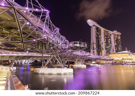 SINGAPORE - AUGUST 4, Marina Bay Sand and Helix bridge on August 4, 2014 in Singapore.They are the attractions of Marina Bay - stock photo