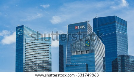SINGAPORE - AUGUST 6, 2014: Modern skyscrapers at Marina Bay Financial Centre in Singapore. Marina Bay Financial Centre was design by Kohn Pedersen Fox and was opened at 2013.