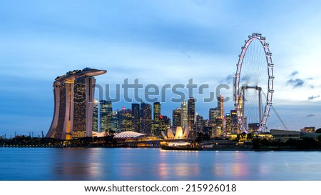 SINGAPORE - AUGUST 07: Panorama landscape of Singapore. Skyline and modern skyscrapers of business district Marina Bay Sands at most financial developing Asian city state. Singapore, AUGUST 07, 2014 - stock photo