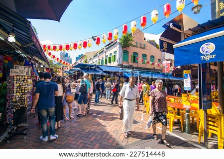 SINGAPORE - AUGUST 10: Singapore's Chinatown, an ethnic neighborhood featuring Chinese cultural elements and a historically concentrated ethnic Chinese population, on August 10, 2014. - stock photo
